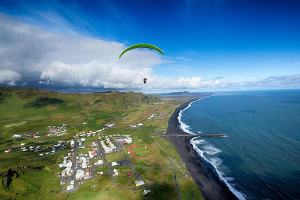 South Coast, Waterfalls and Paragliding Tour from Reykjavik