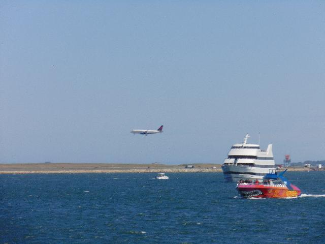 Airplane landing view from Boston Harbour Cruise