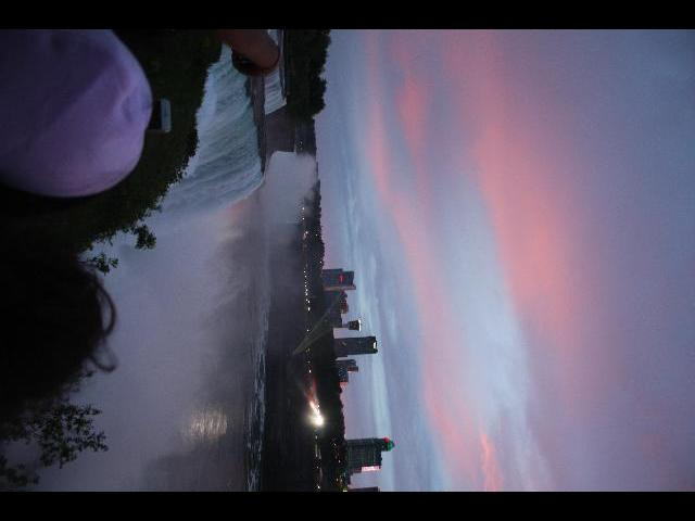 Niagara falls at night with sunset and lights on the falss