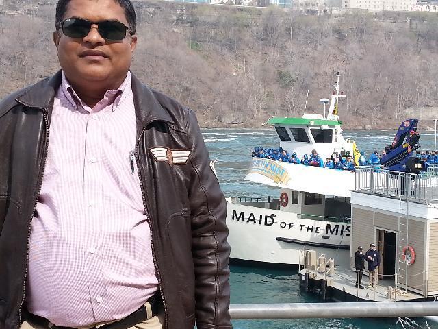 Me at the back drop of Maid of the mist berth at Niagara Falls on 5th May 2015