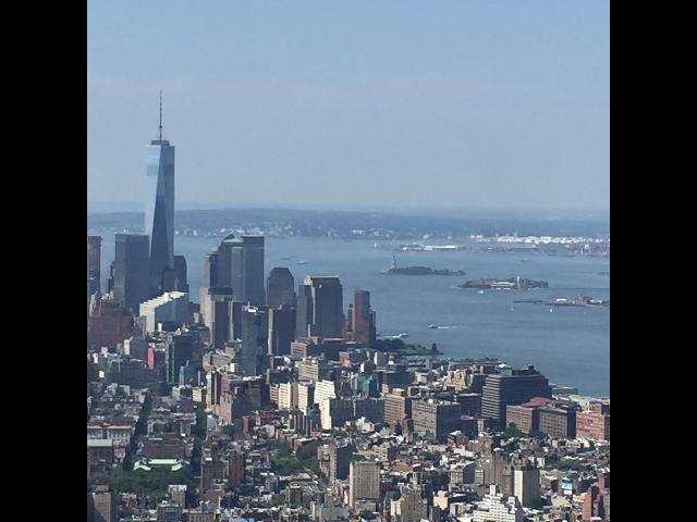 Empire State Building overlooking statue Liberty