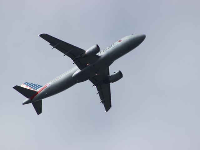 Plane crossing overhead Puerto Rico river