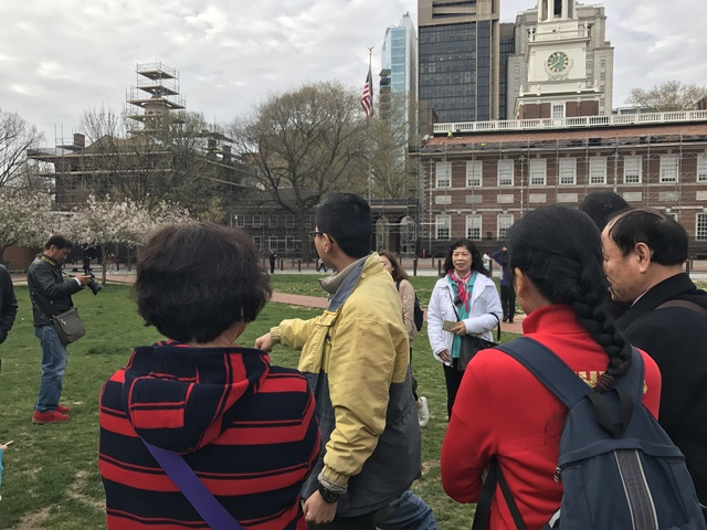 group of people with tour guide.