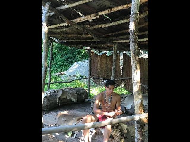Watching the  Wampanoag indian sharpen his knife