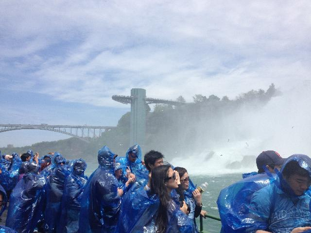 Everyone looking at the falls from the boat
