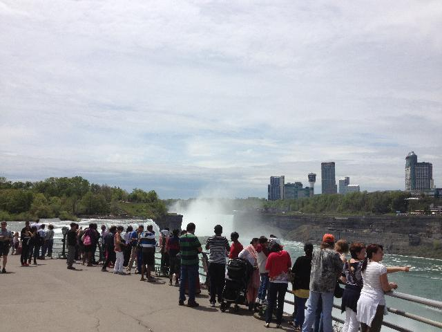 People looking at the falls from the top deck
