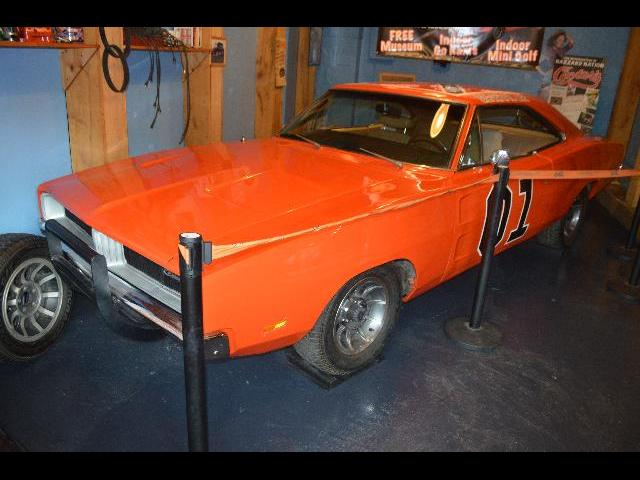 "The General Lee a 1969 Muscle car from the Chrysler Corporation driven by cousins Bo and Luke Duke in the television series The Dukes of Hazzard which is on display at the Ben ""Cooter"" Jones, Cooter's Place Dukes of Hazzard Museum and shop in the city of Gatlinburg, Tennessee USA"