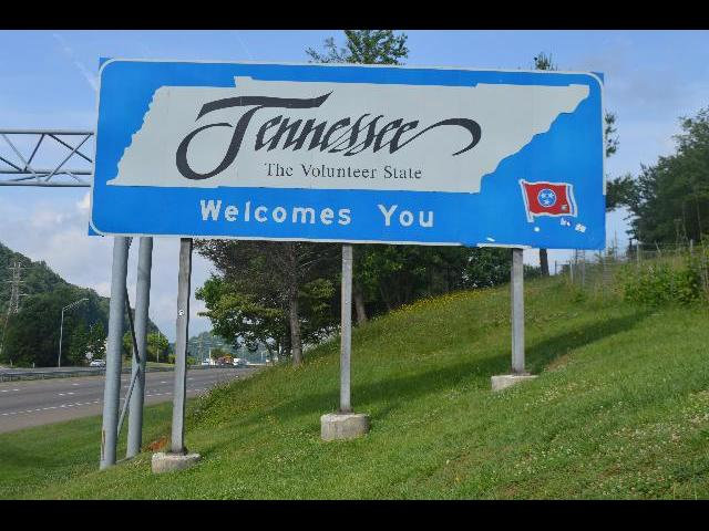 """Tennessee The Volunteer State Welcomes You"" welcome sign crossing the border across the state line into Bristol, Tennessee from Virginia USA"
