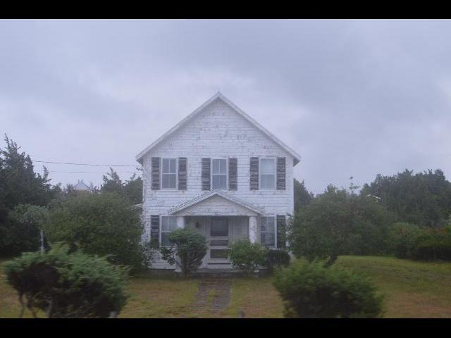 Rustic white painted beach house on Martha's Vineyard Island in Massachusetts USA