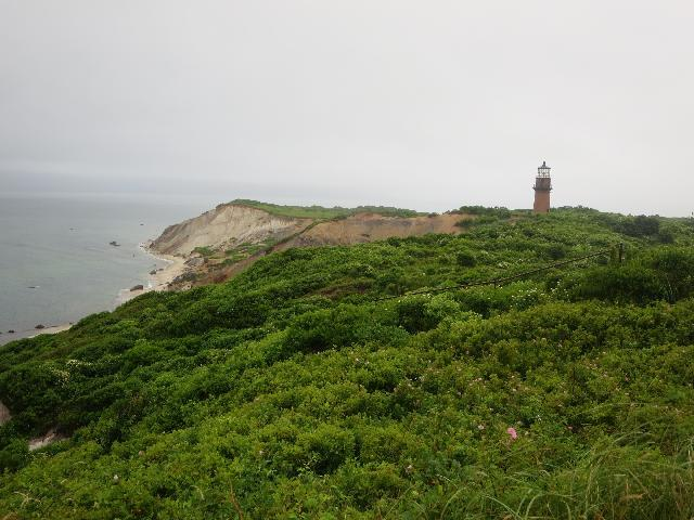 Gay Head Clay Cliffs at the Atlantic Ocean Moshup Beach and Gay Head Lighthouse on Martha's Vineyard Island in the town of Aquinnah Massachusetts USA