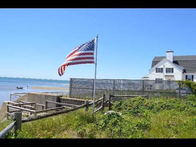 The national flag of the United States of America flying in New England on The Fourth of July Independence Day weekend in Provincetown, Cape Cod, Massachusetts USA