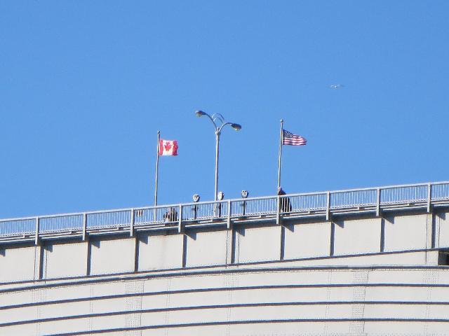 The Canadian flag and the American flag flying at the Canada, U.S.A. border boundary line on Rainbow Bridge