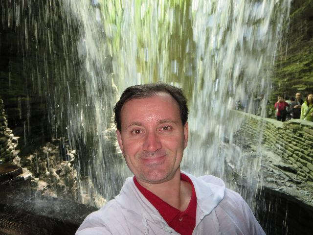 Under a waterfall in Watkins Glen State Park, Finger Lakes, New York, USA
