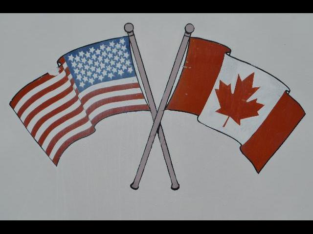 The national flag of the United States of America and The National Flag of Canada flying together on the 1000 Islands Cruise