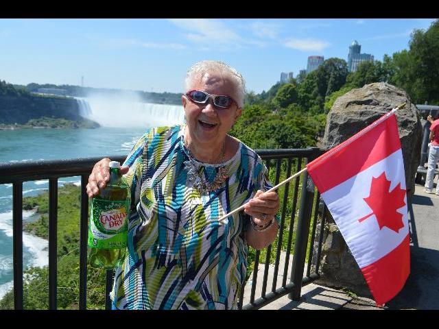 Enjoying refreshing Canada Dry Ginger Ale cold soda while visiting Niagara Falls, Horseshoe Falls, in Ontario, Canada