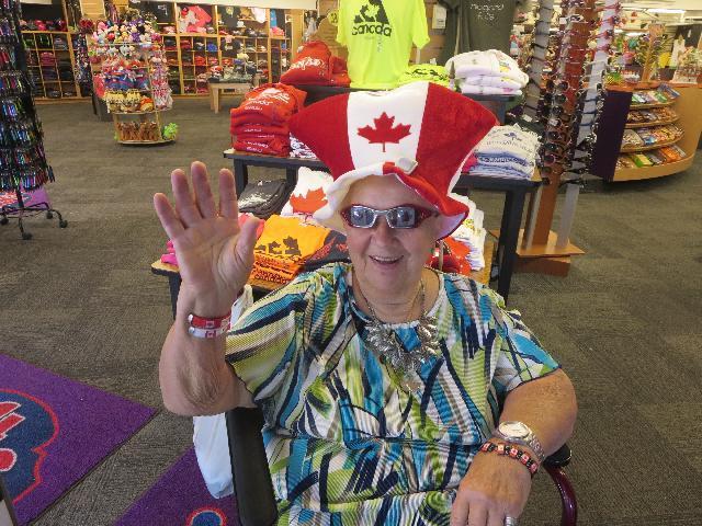 Wearing a National Flag of Canada theme hat, waving hello from Niagara Falls, Horseshoe Falls, in Ontario, Canada