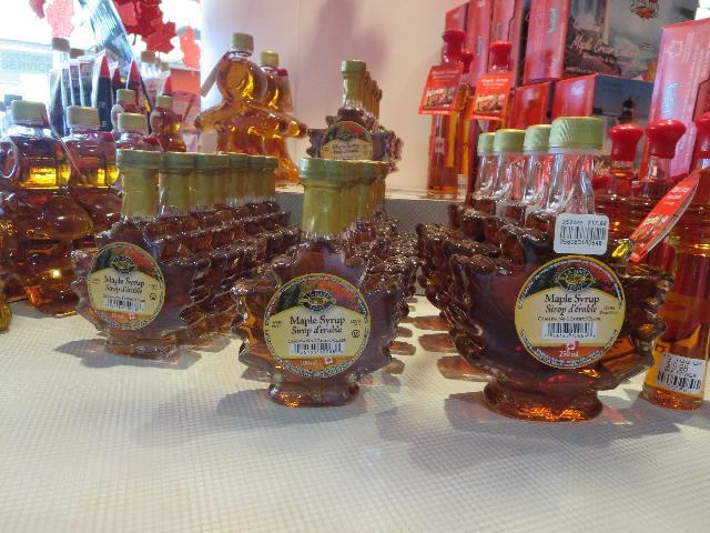 Canadian maple tree leaf shaped L.B. Maple Treat Maple Syrup Sirop d'閞able bottles for sale in Niagara Falls, Ontario, Canada