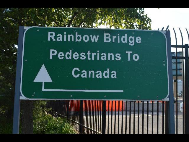 Rainbow Bridge Pedestrians To Canada sign at Rainbow Bridge to the Canadian Province of Ontario from New York state, United States of America