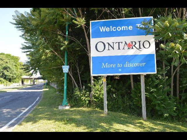 """Welcome to Ontario Canada """"More to discover"""" welcome sign at the international border after crossing Rainbow Bridge into Canada from the USA United States of America"""