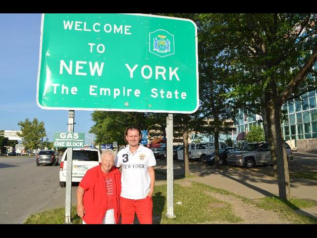 At the Welcome to New York The Empire State sign after crossing the international border across Rainbow Bridge from Ontario Canada into the USA United States of America