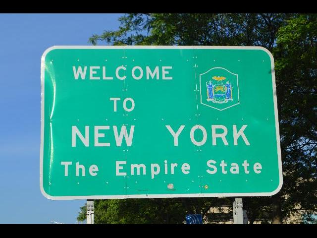 Welcome to New York The Empire State sign after crossing the international border across Rainbow Bridge from Ontario Canada into the USA United States of America