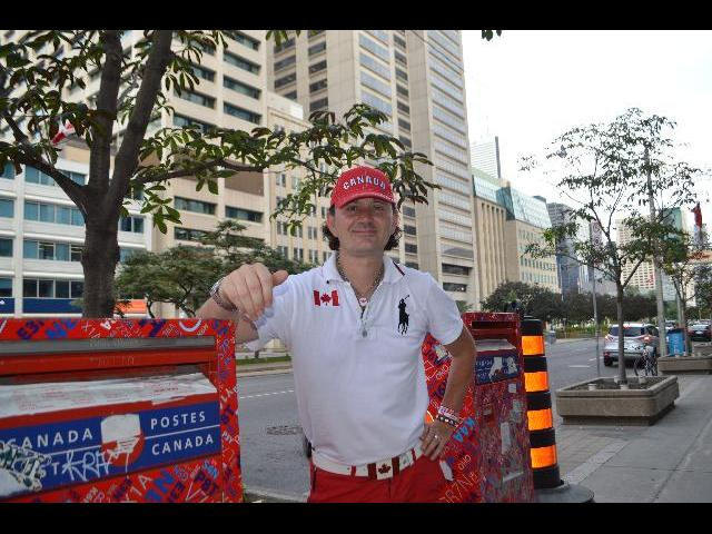 Mailing a letter at Canada Postes mailbox in Toronto, Ontario, Canada