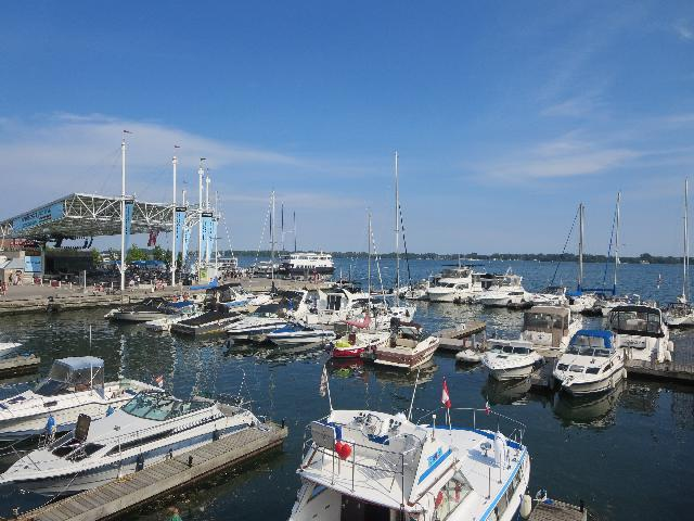 Sailboats docked alongside of WestJet Stage at Harbourfront Centre in Toronto, Ontario, Canada