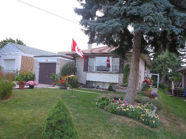 Home flying The Canadian National Flag in Toronto, Ontario, Canada