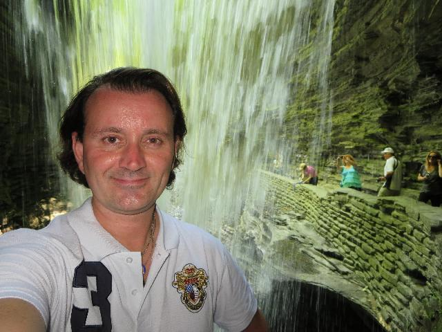 Behind the Cavern Cascade Waterfall in Watkins Glen State Park, Finger Lakes, New York