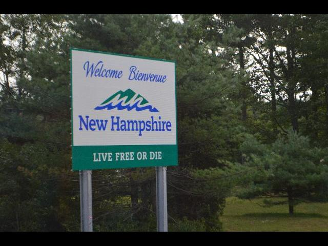 "Welcome Bienvenue New Hampshire ""Live Free or Die"" sign at the state boundry line"