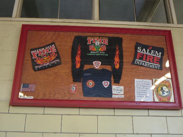 Halloween jack-o'-lantern with fire theme graphic shirts for sale at the Salem Ma Fire Department in Salem, Massachusetts, USA