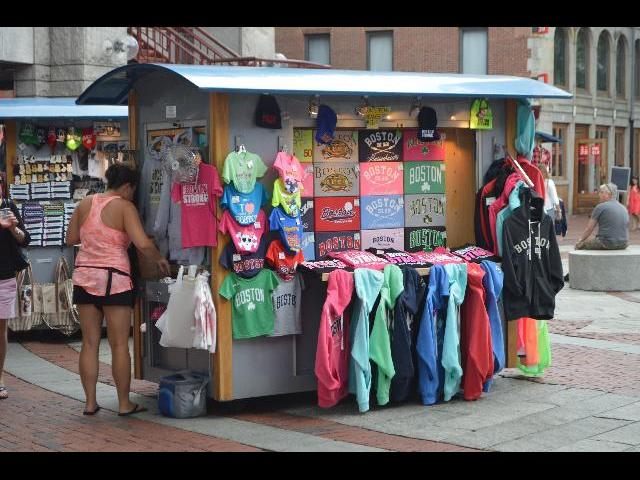 Boston theme graphic t-shirts for sale at Quincy Market in Boston the Capital City of the Commonwealth of Massachusetts USA