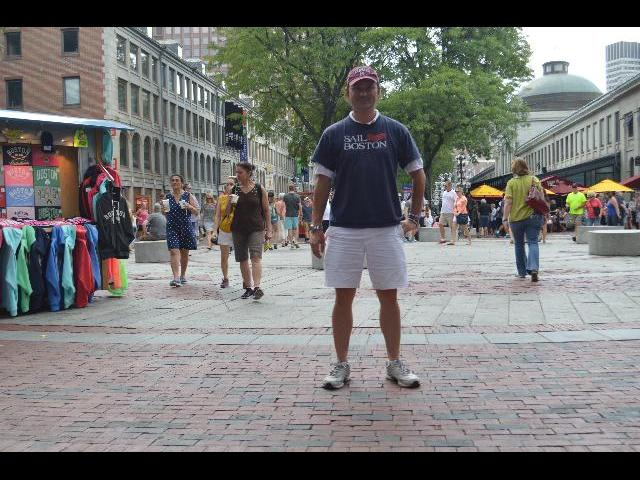 Enjoying a New England summer afternoon at Quincy Market in Boston the Capital City of the Commonwealth of Massachusetts USA