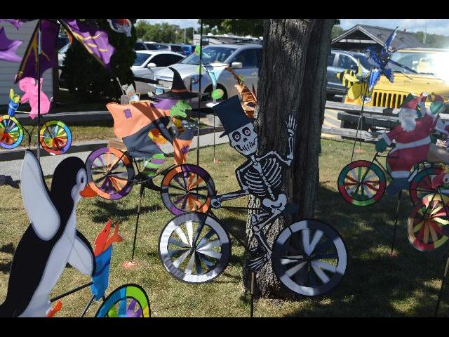 Mystic Kite Shop display of a Happy Halloween / Samhain Festival skeleton riding a bicycle at the Olde Mistick Village in Mystic, Connecticut USA