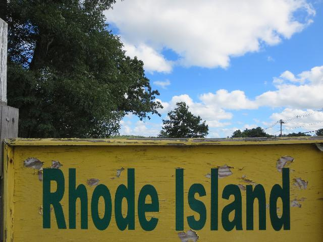 Rhode Island rustic sign painted in yellow and green in West Greenwich, Kent County, Rhode Island, USA
