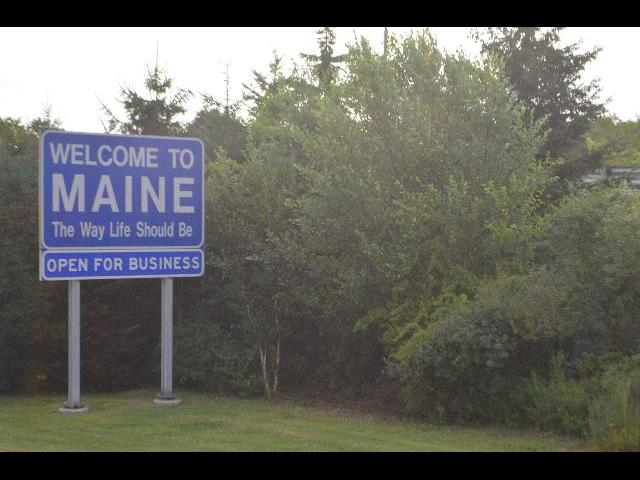 Welcome to Maine The Way Life Should Be Open for Business sign state border entrance sign in Maine, USA