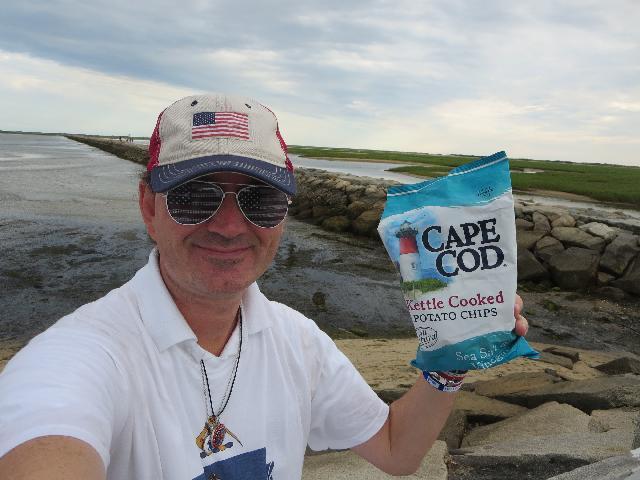 Ryan Janek Wolowski enjoying Cape Cod kettle cooked potato chips in Provincetown, Cape Cod, Massachusetts, New England, USA