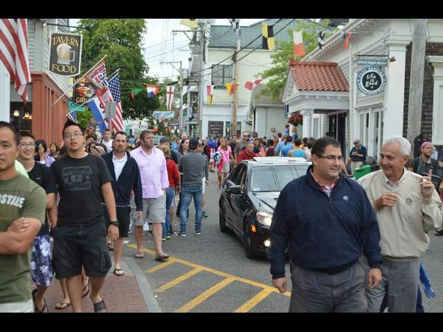 People walk Commercial Street on the Fourth of July in Provincetown, Cape Cod, Massachusetts, New England, USA