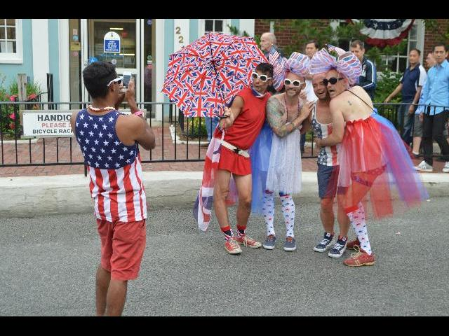 Patriotic USA red white and blue drag queens celebrating the Fourth of July on Commercial Street in Provincetown, Cape Cod, Massachusetts, New England, USA