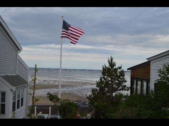 The flag of the United States of America flying on the Fourth of July in Provincetown, Cape Cod, Massachusetts, New England, USA