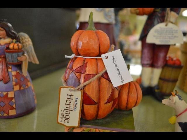 Hand carved wooden Thanksgiving  pumpkin figurine for sale at the Plimoth Plantation living history museum in Plymouth, Massachusetts, New England, USA