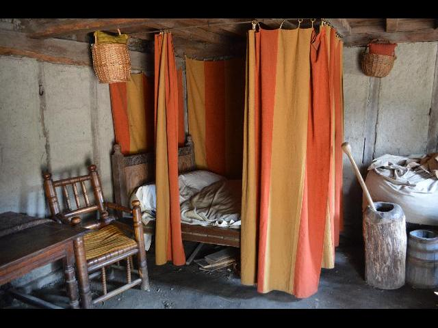 Sleeping area in home of the 17th-Century English Village at the Plimoth Plantation living history museum in Plymouth, Massachusetts, New England, USA