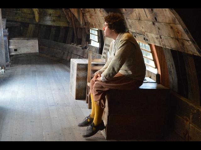 Pilgrim on board the Mayflower II 17th-century Pilgrim ship in Plymouth, Massachusetts, USA