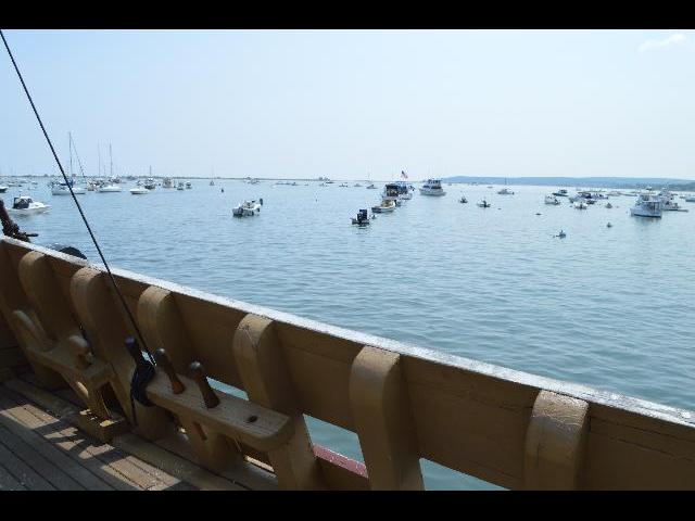 Boats docked in Plymouth Bay as seen from the Mayflower II 17th-century Pilgrim ship in Plymouth, Massachusetts, USA