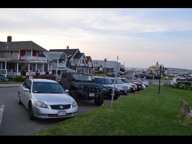 Cars park alongside of Ocean Park in Oak Bluffs, on Martha's Vineyard Island in Massachusetts USA