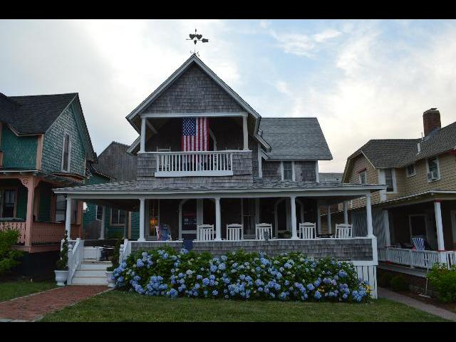 Beach house flying the flag of the United States of America in Oak Bluffs, on Martha's Vineyard Island in Massachusetts USA