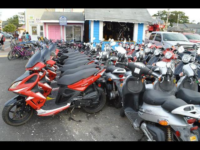 Kymco motor scooters at Moped & Bicycle Rentals location in Oak Bluffs on Martha's Vineyard Island in Massachusetts USA