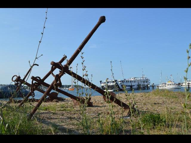 Rustic boat anchors at the shore in Vineyard Haven on Martha's Vineyard Island in Massachusetts USA