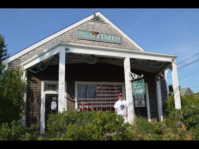 Ryan Janek Wolowski visiting the Martha's Vineyard Times weekly newspaper office in Massachusetts USA