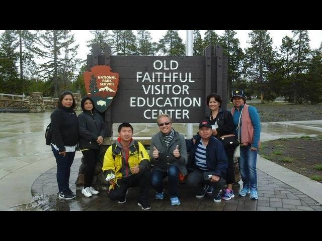 Old Faithful Geyser, Yellowstone National Park with our tour guide, Matthew